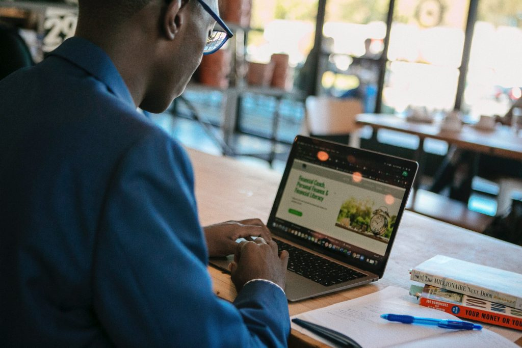 Kofi Gyebi at coffee shop typing